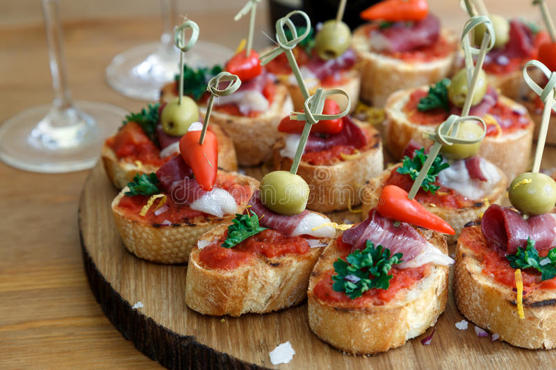 Pinchos, tapas, spanish canapes, party finger food. Pintxos, tapas, spanish canapes party finger food stock images