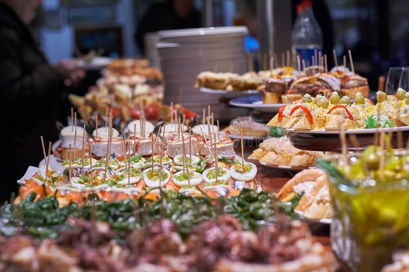 Pinchos and tapas typical of the Basque Country, Spain. Selection of different types of foods to choose from. San Sebastian royalty free stock photo