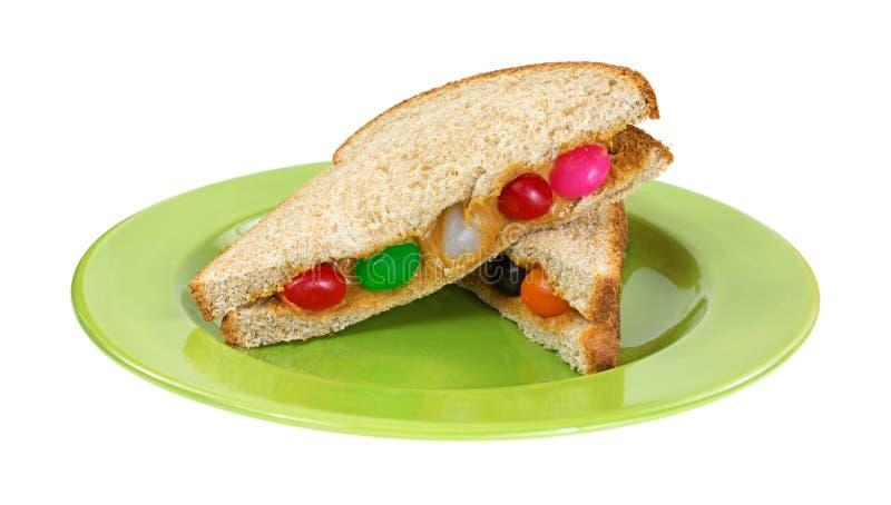 Pindakaas en geleiboonsandwich op plaat royalty-vrije stock afbeelding