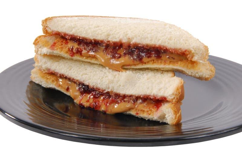 Pindakaas en geleisandwich stock foto