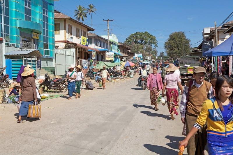 Pindaya. Burmese people are walking along the street in Pindaya, Myanmar or Burma, during a market day stock images