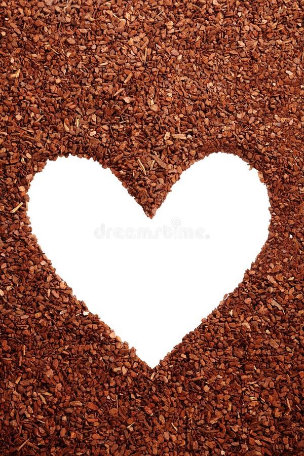 Pine bark mulch surrounding white heart symbol stock photos