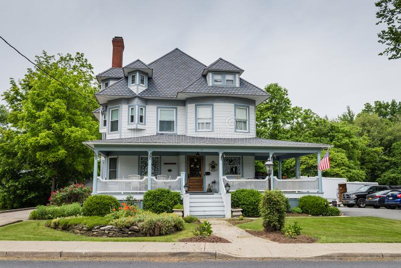 Pine Bush House Bed and Breakfast Front Facade. Pine Bush, NY /USA - June 9, 2018: Front exterior view of Victorian manor now known as the Pine Bush House Bed stock photo