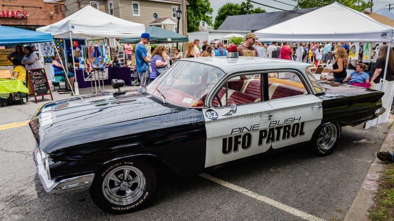 Pine Bush UFO Fair UFO Patrol Vehicle. Pine Bush, NY /USA - June 9, 2018: Black and white UFO Patrol car stock image