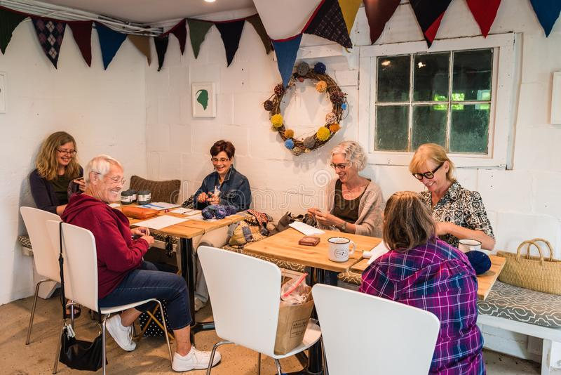Womens Knitting Circle In Hudson Valley. Pine Bush, NY /USA - June 9, 2018: Group of women gather to knit royalty free stock image