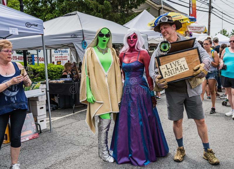 Pine Bush UFO Fair Alien Stroll. Pine Bush, NY /USA - June 9, 2018: Tourist snaps photo at Alien Stroll royalty free stock image