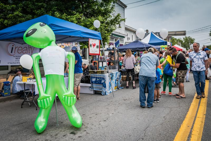 Pine Bush UFO Fair Green Alien. Pine Bush, NY /USA - June 9, 2018: Plastic green alien guards fair stock photos