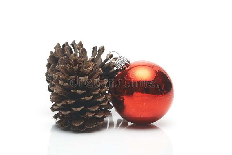Pine cone Christmas decoration red ball stock photography