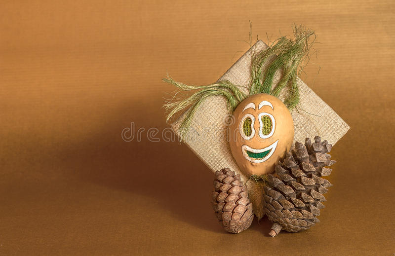 Pine cone and spirit of the wood mask decoration stock image