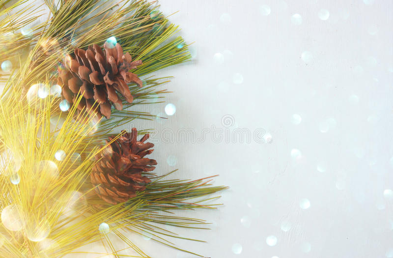 Pine cones decoration for christmas and holiday bokeh lights stock photo