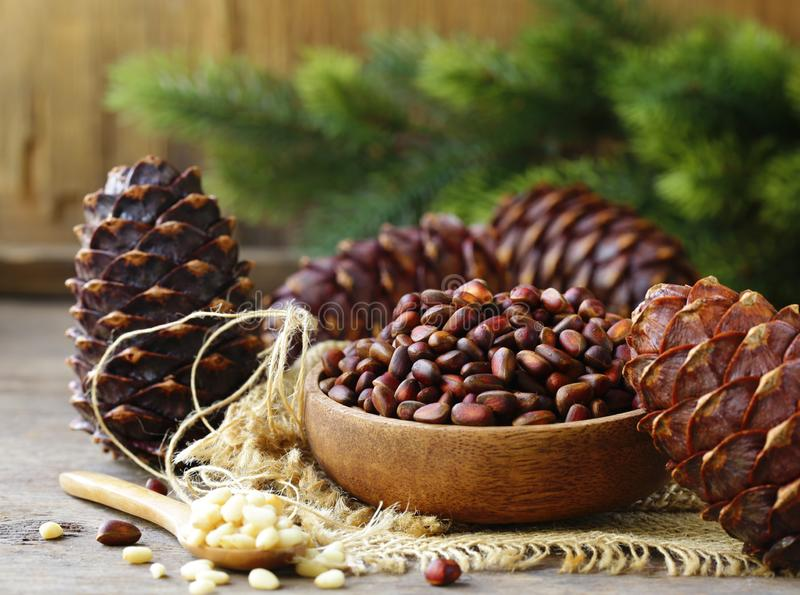 Pine cones and nuts stock photos