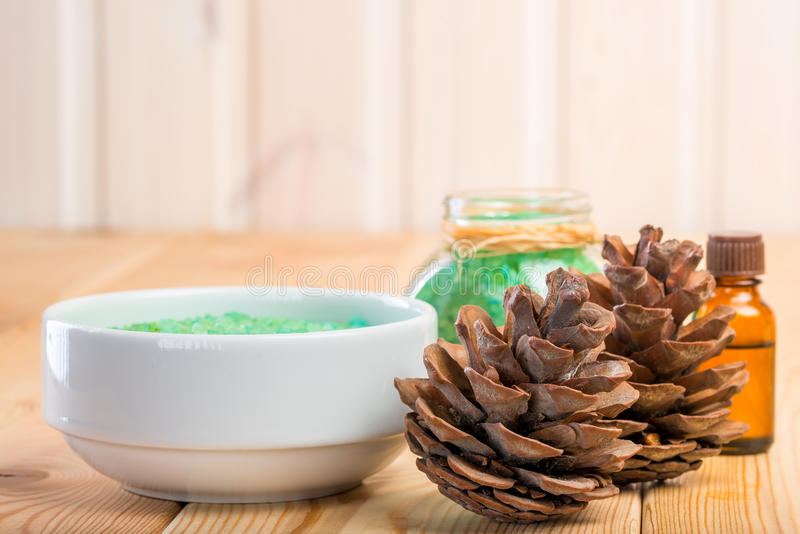 Pine cones and sea salt for bathing with pine extract royalty free stock image