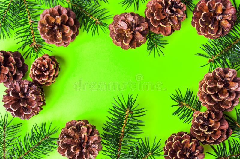 Pine cones on yellow background festive background royalty free stock images