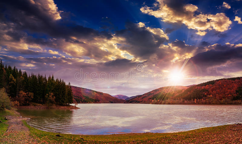 Download Pine Forest And Lake Near The Mountain At Sunset Stock Photo - Image: 38262622