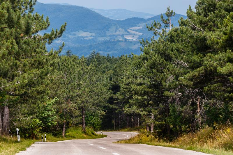 Mountain road on a sunny day with panorama royalty free stock photography
