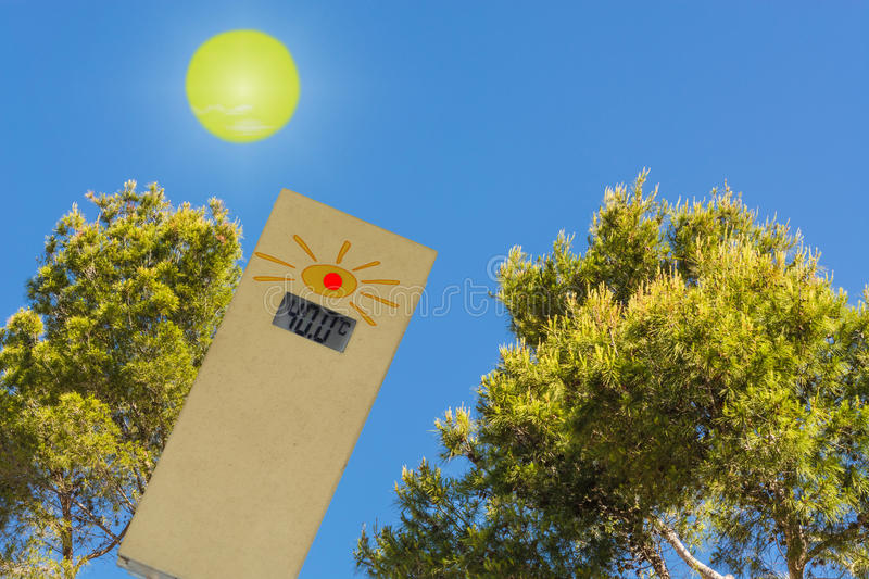Pine forest in Spain against blue sky. Thermometer in the sun shows 40 degrees. Concept hot summer day and high outside temperatures against a blue sky stock photography