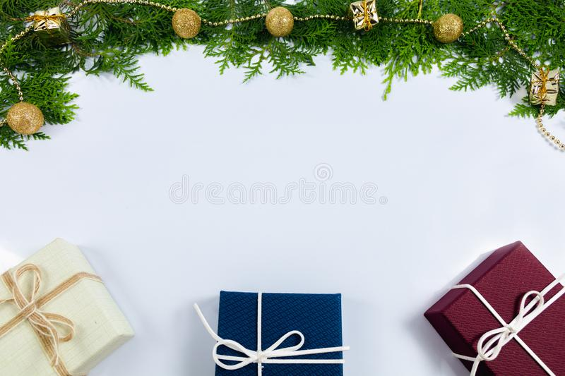 Pine leaf and gift box royalty free stock image