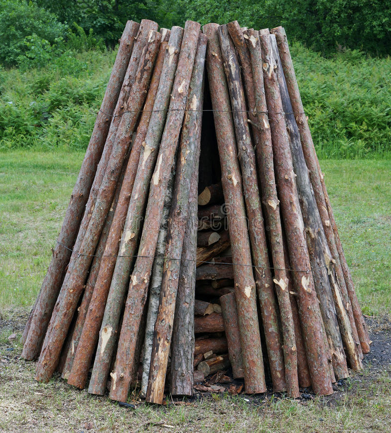 Pine logs are put in a pyramid for a traditional ritual pagan fire. stock photos