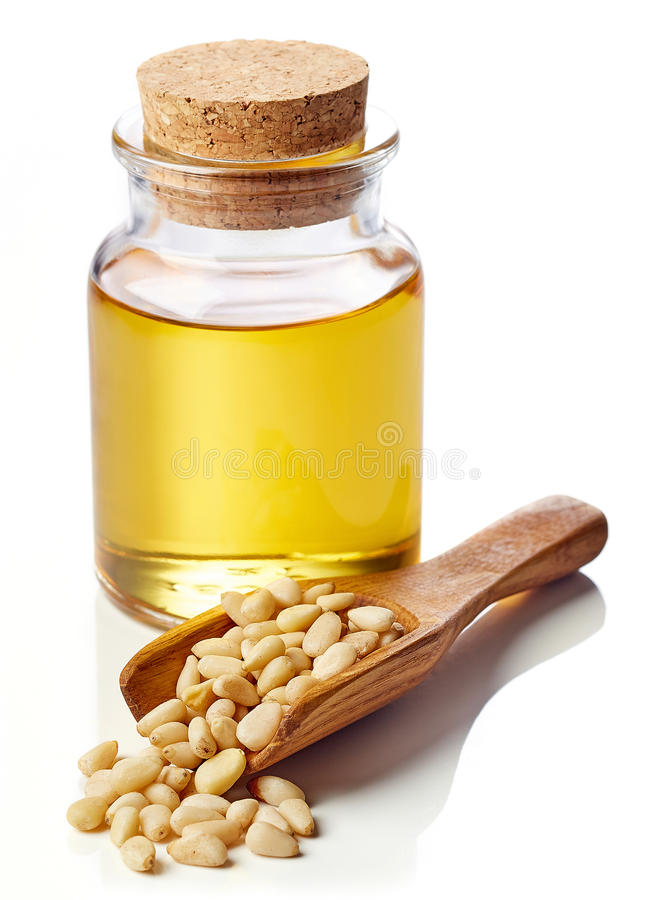 Pine nut oil and pine nuts royalty free stock photos