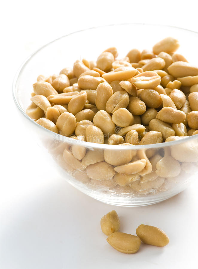 Pine nuts. Glass bowl with big pile of pine nuts stock image