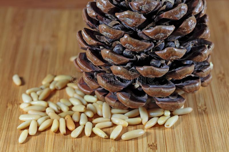 Pine Nuts. Or Pignoli on a wooden surface stock photography