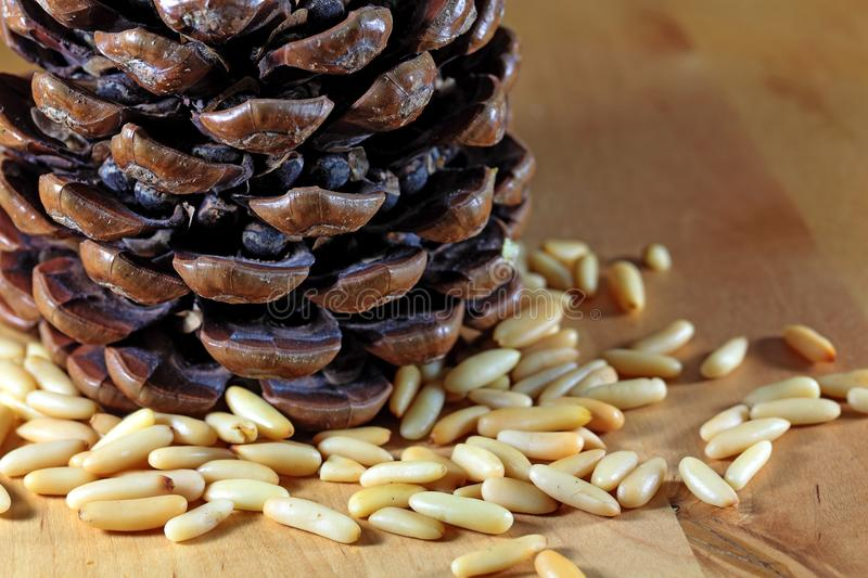 Pine Nuts. Or Pignoli on a wooden surface stock image