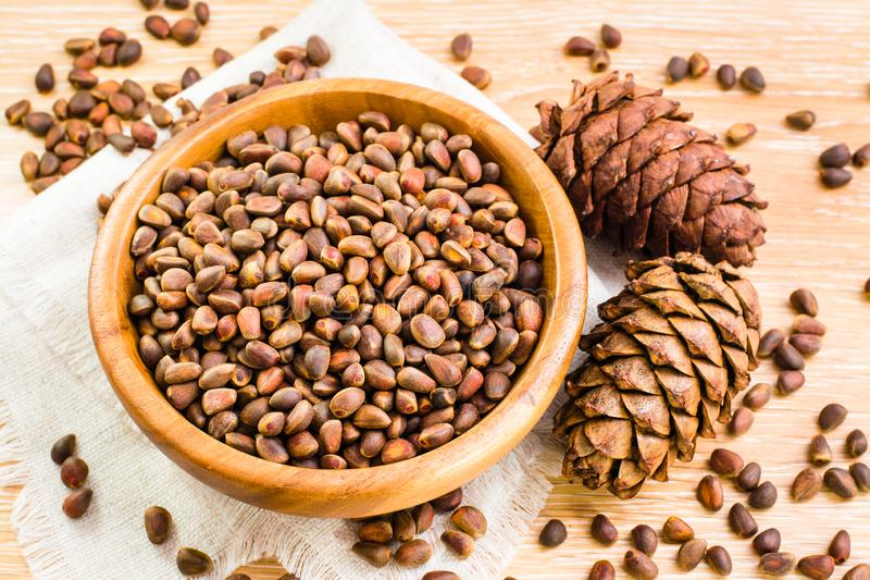 Pine nuts and ripe cedar cones royalty free stock images