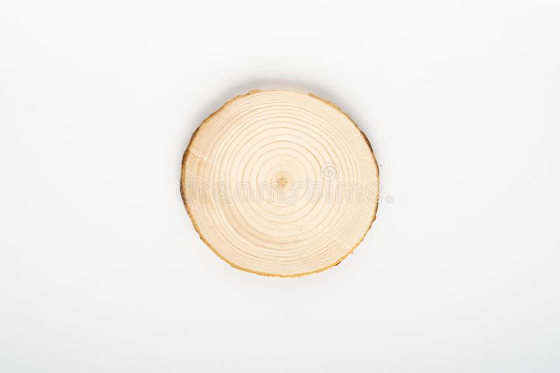 Pine tree cross-section with annual rings on white background. Lumber piece close-up, top view, isolated. Pine tree cross-section with annual rings on white royalty free stock image