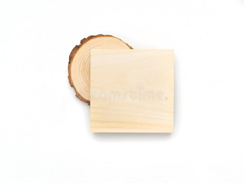Pine tree cross-section and wooden square on white background. Lumber piece close-up, top view. Pine tree cross-section and wooden square on white background royalty free stock images