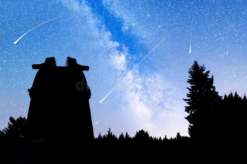 Pine trees silhouette Milky Way observatory Falling stars stock photos