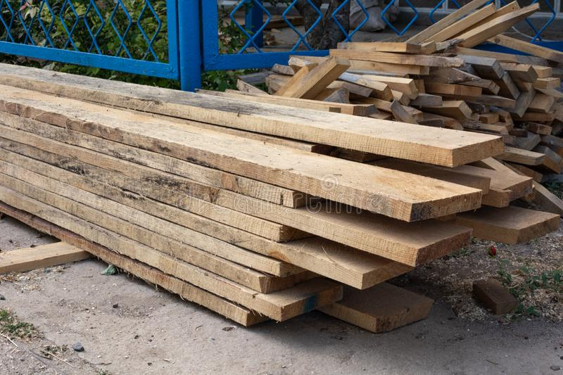 Pine wood timber stack of natural rough wooden boards on building site royalty free stock image