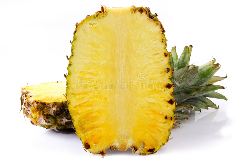 Pineapple. Two helves of pineapple on white background royalty free stock images