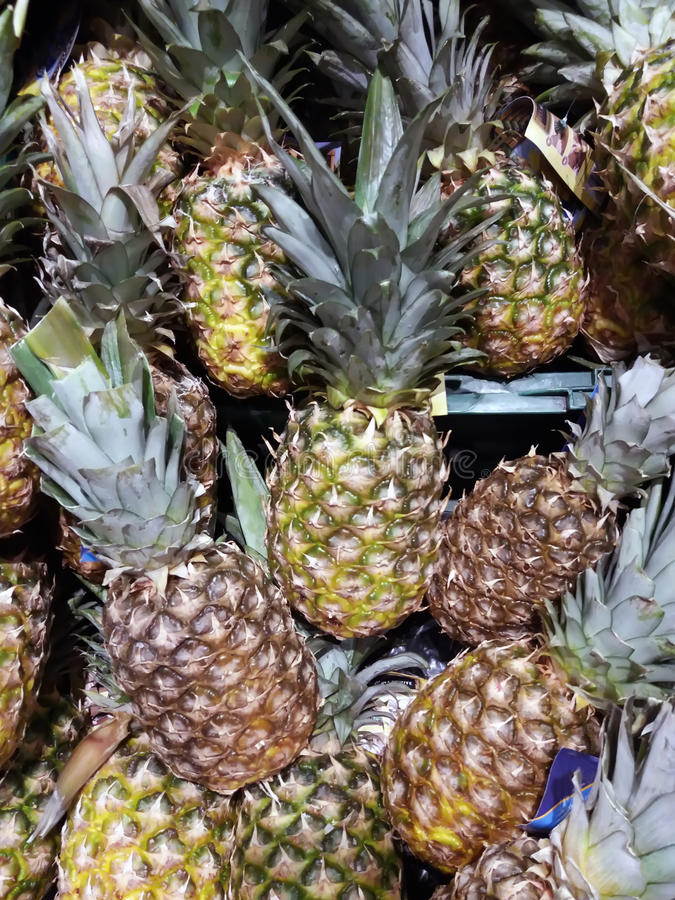 Pineapple background. A lot of tropical ananas fruit stock photo