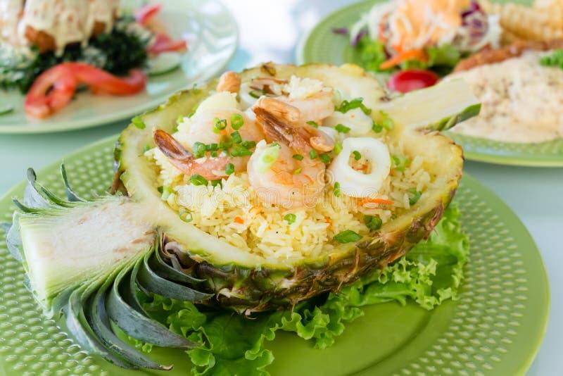 Pineapple baked rice stock photos