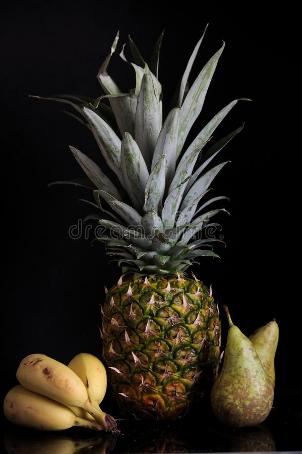 Pineapple, bananas and pears royalty free stock photography