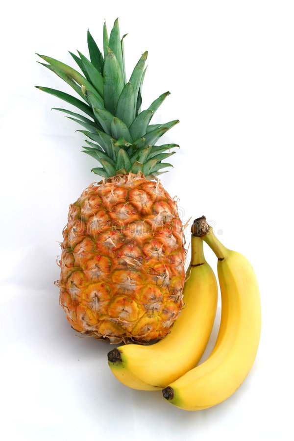 Pineapple and bananas on white royalty free stock photos