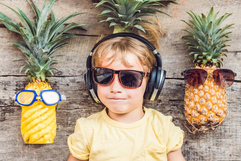 A pineapple boy and pineapples on vacation stock images