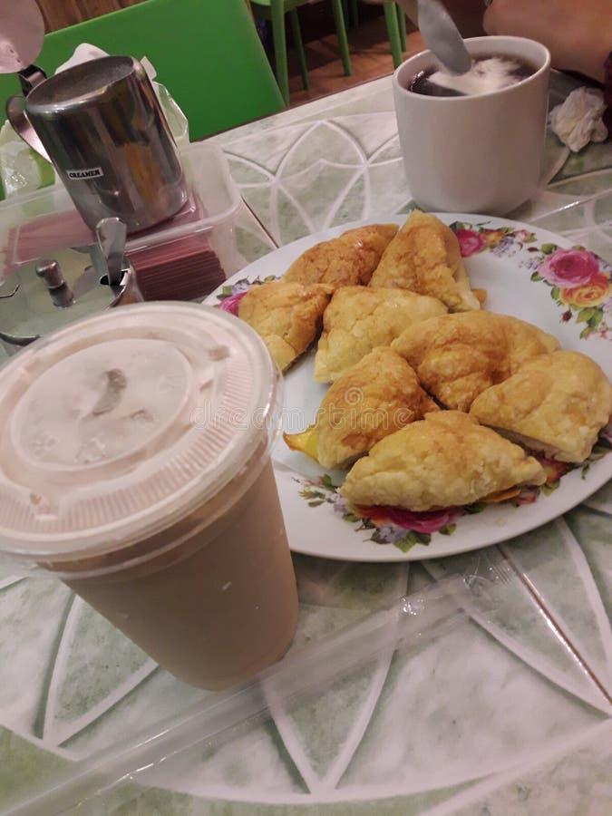 Pineapple Bun + Wintermelon Tea. A nice combination for a snack in Binondo, Manila stock images