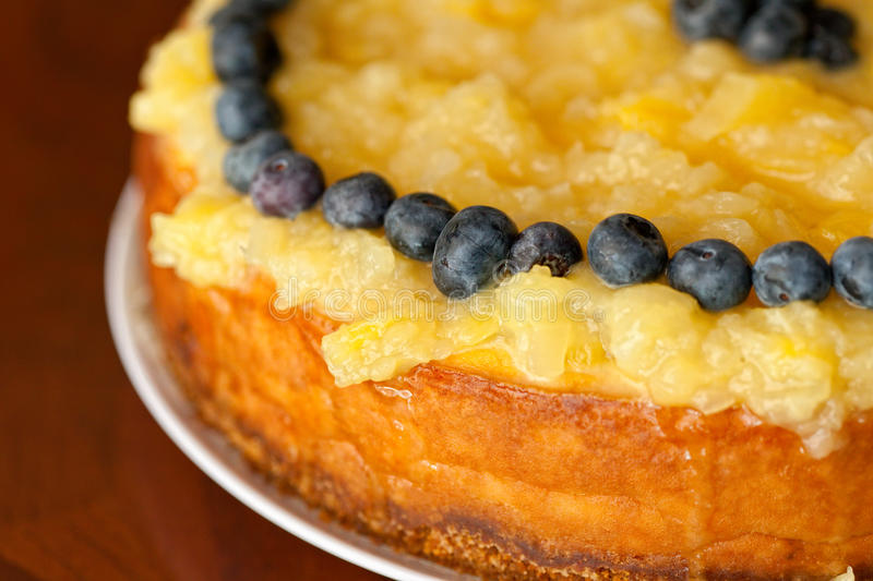 Pineapple Cheesecake with Blueberries royalty free stock photography