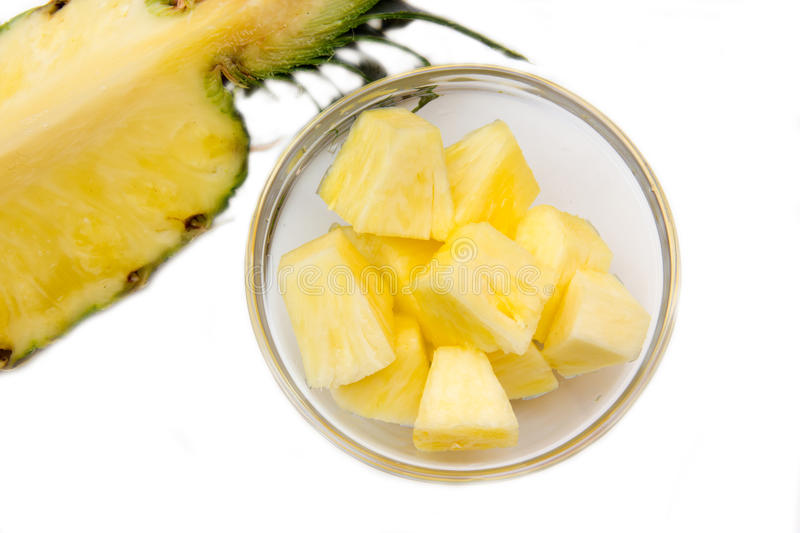 Pineapple cubes on bowl from above royalty free stock photos