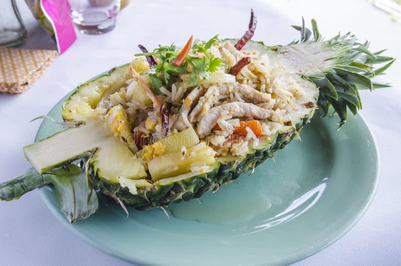 Pineapple Fried Rice. On dish stock photo