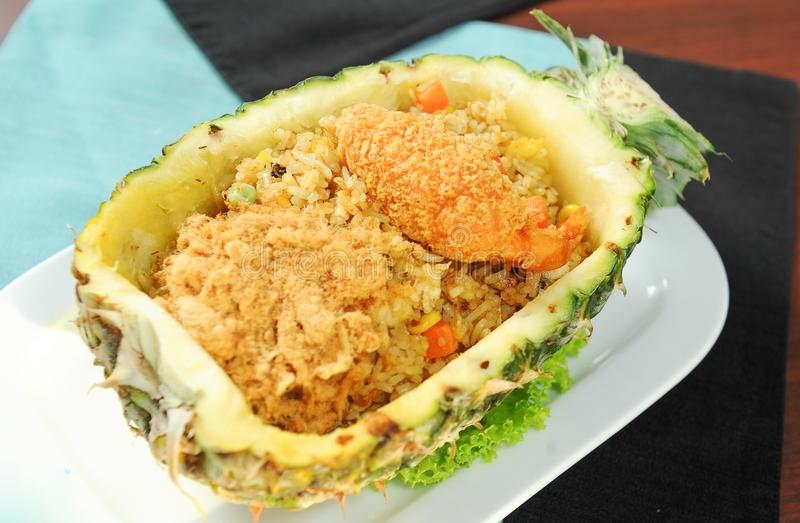 Pineapple with fried rice. Close up pineapple with fried rice royalty free stock images