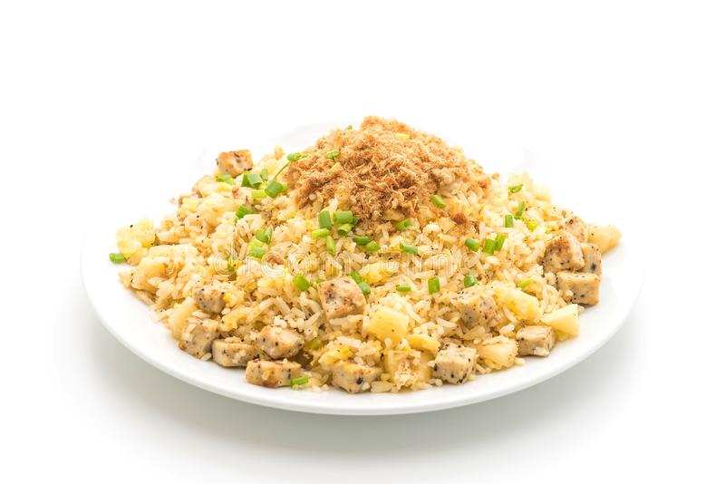 Pineapple fried rice with dried shredded pork. Isolated on white background stock photo