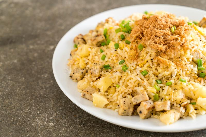 Pineapple fried rice. With dried shredded pork stock photo