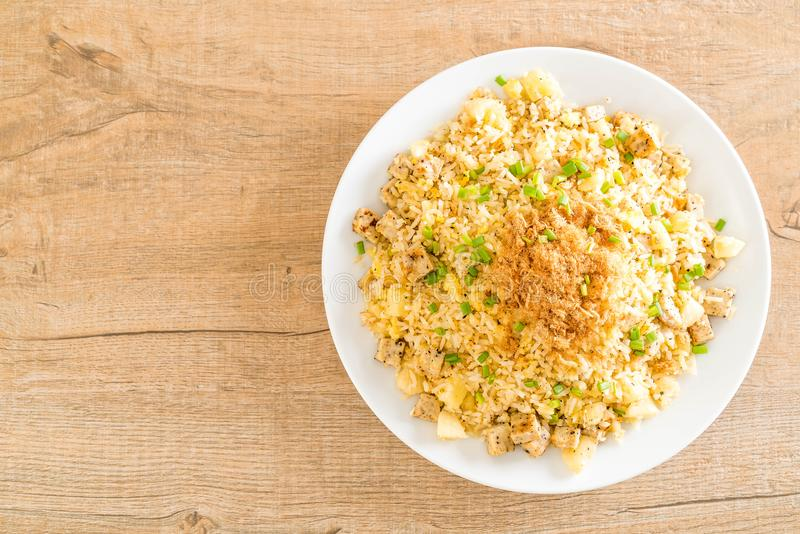 Pineapple fried rice. With dried shredded pork stock image