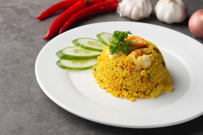 Pineapple fried rice. On table royalty free stock photo