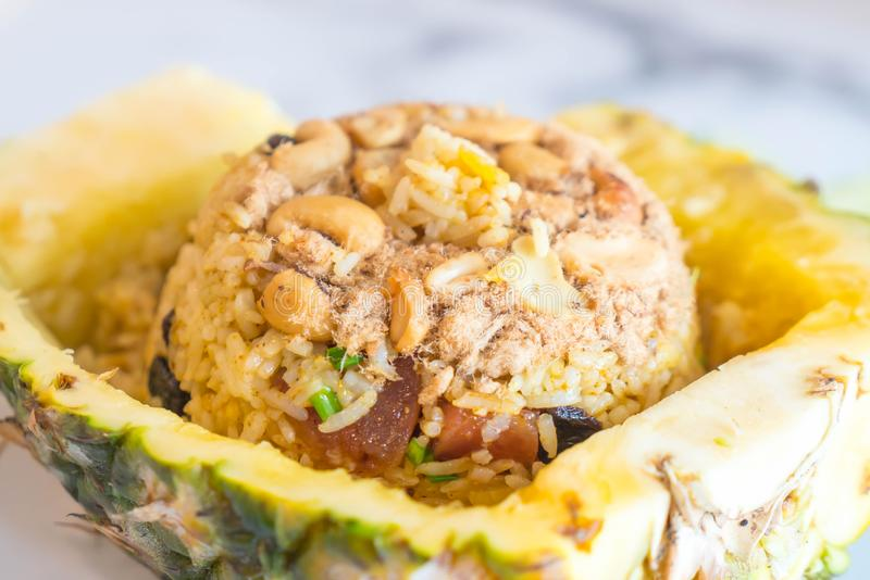 Pineapple fried rice. On table stock image
