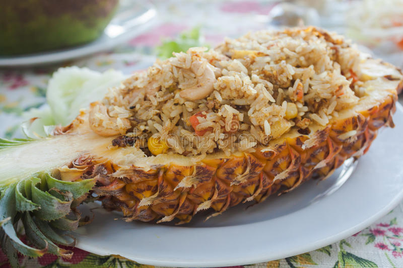 Pineapple fried rice, a traditional dish of Thai, Vietnamese and. Freshly prepared pineapple fried rice served inside of a pineapple carved like a bowl royalty free stock photography