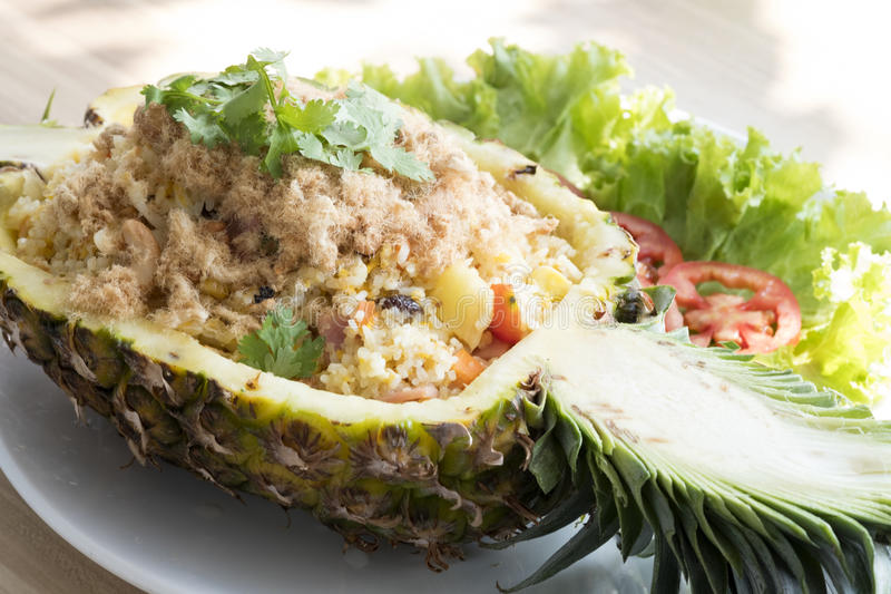 Pineapple Fried Rice. On white dish royalty free stock photography