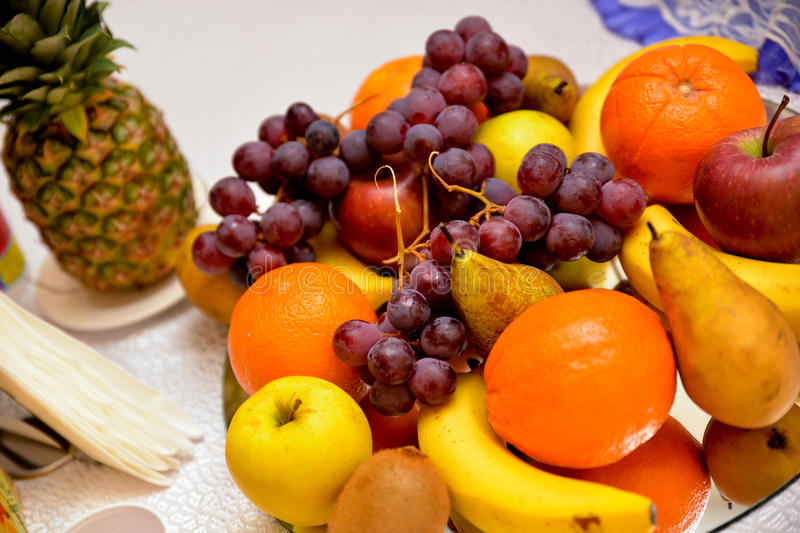 Pineapple, grapes, oranges, apples, bananas, pears stock photos